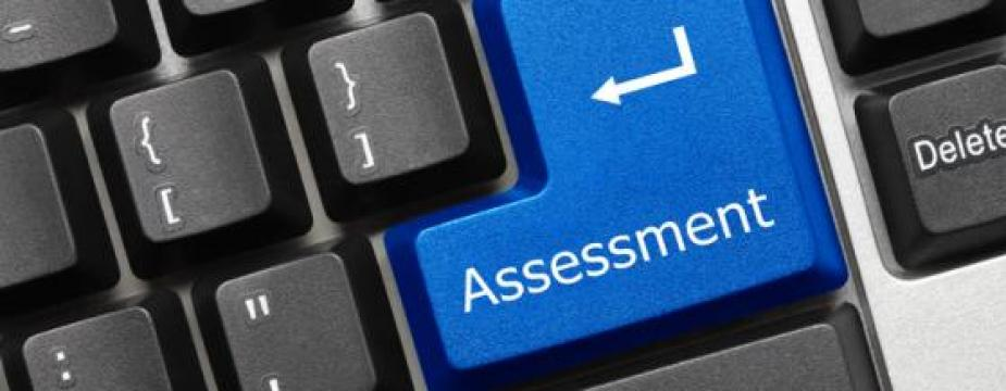 Large enter key with the word assessment written on it